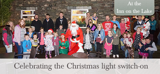 Christmas light switch on at the Inn o the Lake